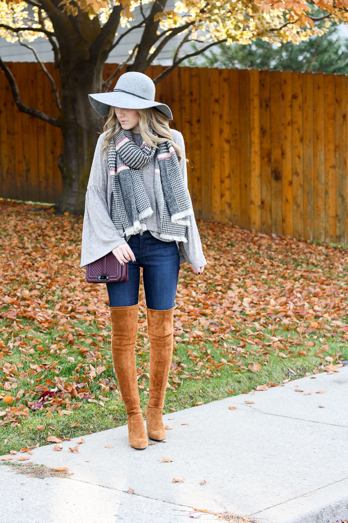 Bell sleeve sweater with a plaid scarf and over the knee boots
